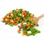 Mexican frozen vegetables on a wooden spoon