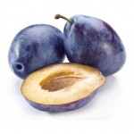 Plums with half of one isolated on a white background.